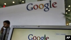 A security guard answers the phone at the reception counter of a Google office. (File Photo)