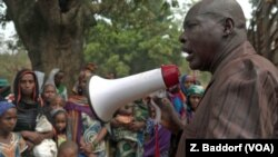 FILE - Ibrahim Abaka, the president of an internally displaced persons camp, uses a megaphone to organize the distribution of food aid in Bambari, Central African Republic, January 2017.