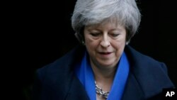 Britain's Prime Minister Theresa May leaves 10 Downing Street for Prime Minister's Questions at the House of Commons, in London, Wednesday Dec. 19, 2018. (AP Photo/Tim Ireland)