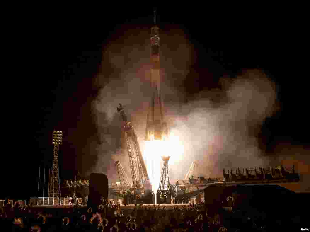 A Soyuz rocket with Expedition 36/37 Soyuz Commander Fyodor Yurchikhin of the Russian Federal Space Agency, Flight Engineers Luca Parmitano of the European Space Agency and Karen Nyberg of NASA, onboard, launches from the Baikonur Cosmodrome in Kazakhstan to the International Space Station.