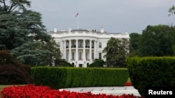 View of the White House and South Lawn fountain, Washington, May 28, 2013.