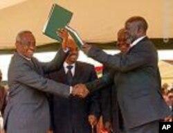 Sudan Vice President Taha (left)