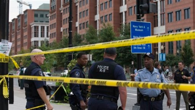 Police work the scene in Washington after a shooting at a Navy building in Washington, D.C.