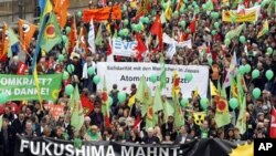 Anti-nuclear demonstrators march in Cologne, western Germany, March 26, 2011, to protest against nuclear power
