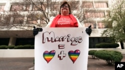 Helen Barnes holds a sign of support for gay marriage outside the 5th U.S. Circuit Court of Appeals in New Orleans, Jan. 9, 2015.