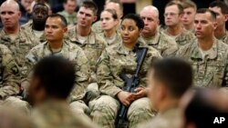 FILE - Soldiers listen to U.S. Defense Secretary Ash Carter at Kandahar Airfield in Afghanistan, Feb. 22, 2015.