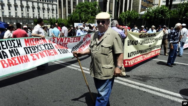 A pensioner joins a demonstration against new austerity measures in Athens June 9, 2011