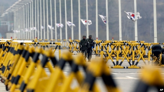 South Korean army soldiers walk by barricades set up on Unification Bridge near the border village of Panmunjom.