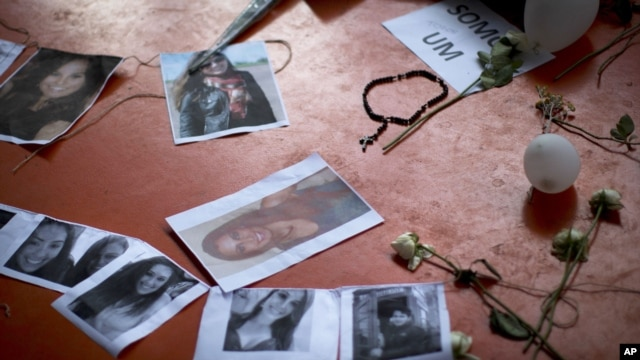 A makeshift memorial that include pictures of the victims of the Kiss nightclub fatal fire is seen inside the gymnasium where a collective funeral was held a day earlier, in Santa Maria, Brazil, January 29, 2013.