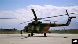 This May 13, 2013 file photo shows a Mi-17 helicopter, used by the Afghan air force sitting on Bagram Air Field in Afghanistan. It is one type of helicopter Nigeria is buying from Russia.