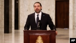 FILE - Lebanese Prime Minister Saad Hariri speaks to journalists at the presidential palace in Baabda, east of Beirut, Lebanon, Nov. 3, 2016.