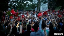 Turkish protesters sing and shout slogans during a demonstration at Taksim Square in Istanbul, June 5, 2013.