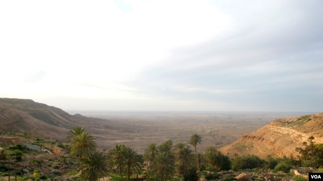 Overlooking a valley in the Nafusa Mountain area, Libya, April 9, 2012. At the far left, white streaks running down the mountain signal oil pipelines buried below. (Stephanie Figgins)