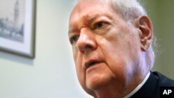 FILE- Cardinal Edward Egan, shown in August 2011, succeeded Cardinal John O'Connor as archbishop and formerly served as bishop of Bridgeport, Connecticut.
