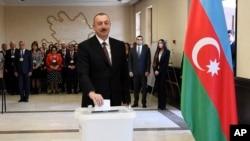 Azerbaijan's president, Ilham Aliyev, casts his ballot at a polling station during presidential elections in Baku, Azerbaijan, April 11, 2018.