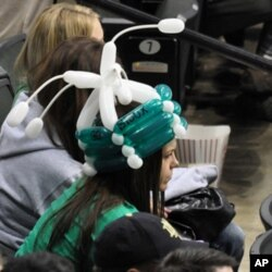 This woman sports a Fighting Sioux war bonnet, albeit one that's not very fearsome.