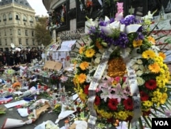 FILE - Mementos, flowers and messages left at the Place de la Republique in Paris, France in honor of the November 13 terror attacks, Nov. 16, 2015. (Photo: D. Schearf / VOA)
