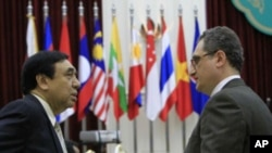 Russian Deputy Foreign Minister Igor Morgulov, left, talks with ASEAN's Deputy Secretary-General Nyan Lynn, right, before the ASEAN-Russia Ministerial Meeting in Phnom Penh, Cambodia, July 11, 2012.