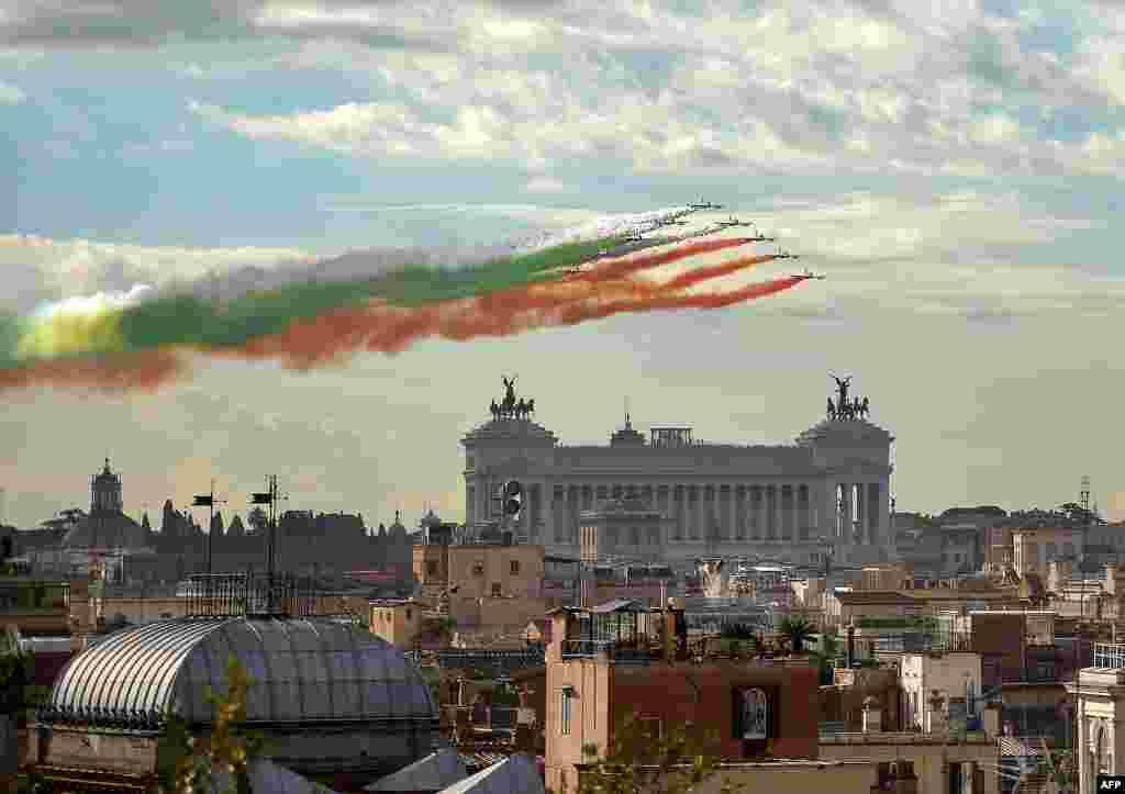 The Italian Air Force aerobatic unit Frecce Tricolori spreads green, white and red smoke in the colors of the Italian flag marking the day of National Unity and Armed Forces in Rome.