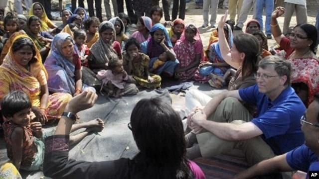 Microsoft Corp co-founder Bill Gates and his wife Melinda interact with slum dwellers during their visit to a slum area in Danapur near the eastern Indian city of Patna March 23, 2011