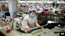 North Korean workers sew items at a factory of a South Korean-owned company at the jointly-run Kaesong Industrial Complex, in Kaesong, North Korea.