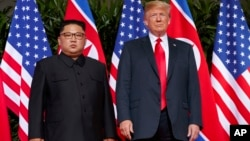 FILE - U.S. President Donald Trump, right, meets with North Korean leader Kim Jong Un on Sentosa Island, in Singapore, June. 12, 2018.