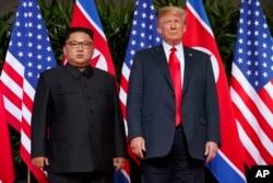 FILE - U.S. President Donald Trump, right, meets with North Korean leader Kim Jong Un on Sentosa Island, in Singapore, June. 12, 2018.