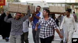 Bombing victims are taken for burial in the Sh'iite holy city of Najaf, Sept. 15, 2013.