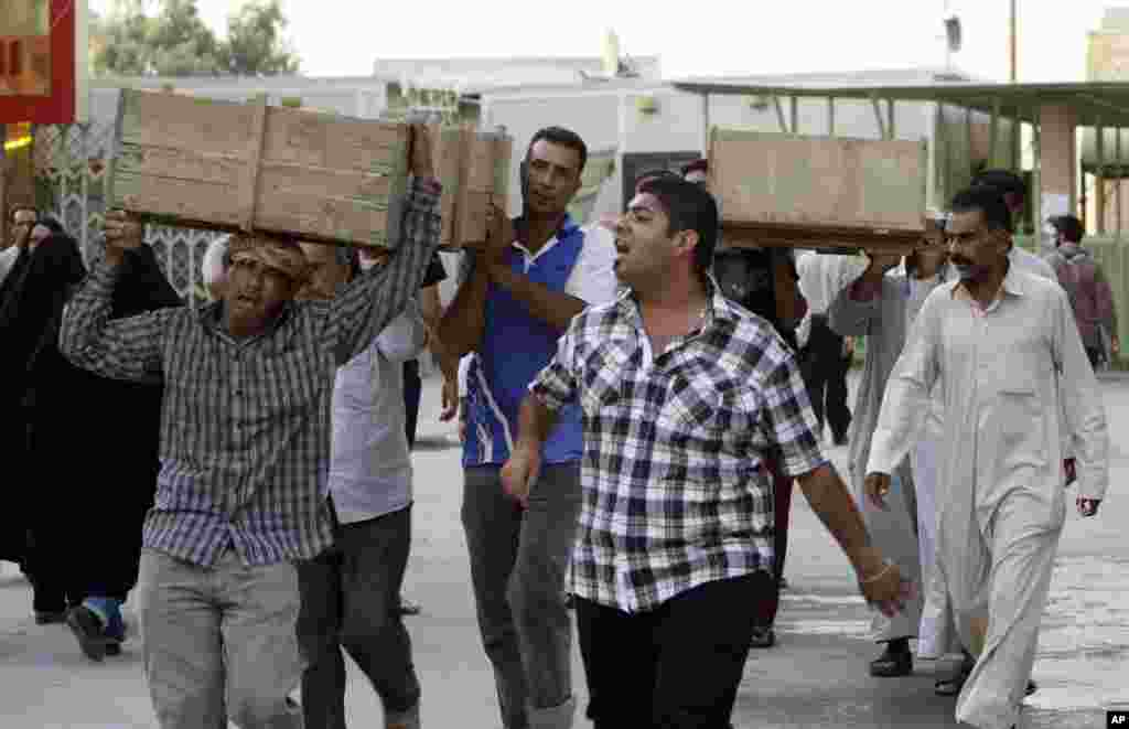 Bombing victims are taken for burial in the Shiite holy city of Najaf, Sept. 15, 2013.