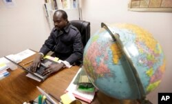 Sudanese refugee Suliman Bandas, who teaches English as second language, works in his classroom in Lincoln, Nebraska, Jan. 4, 2017.