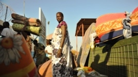 Residents of Juba arrive at the UN compound on December 20, 2013 where they sought shelter. African diplomats made a push for peace in South Sudan on Friday as bitter fighting spread across the world's youngest nation.