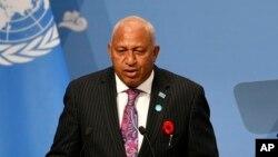 FILE - Fiji's Prime Minister Frank Bainimarama talks at the U.N. Climate Change Conference in Bonn, Germany, Nov. 6, 2017.
