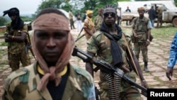 FILE - Seleka fighters at their base before a mission in the town of Lioto, Central African Republic, June 9, 2014.