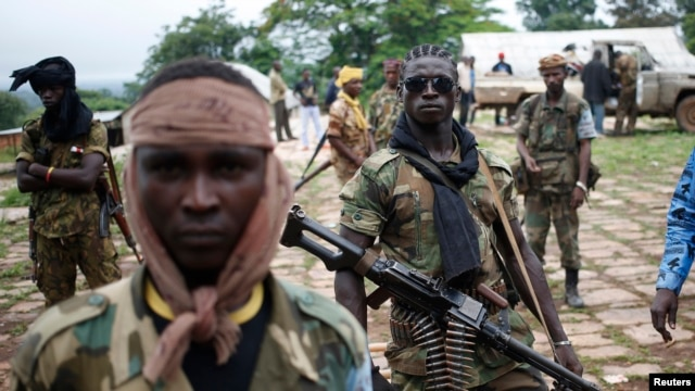 FILE - Seleka fighters stand in their base before a mission in the town of Lioto, Central African Republic, June 9, 2014.