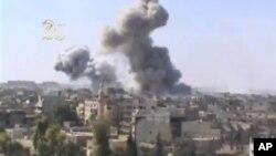 Khói bốc lên sau vụ oanh kích của phe chính phủ tại vùng ngoại ô Damacus, 29/10/2012
