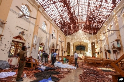 Dead bodies of victims lie inside St. Sebastian's Church damaged in blast in Negombo, north of Colombo, Sri Lanka, April 21, 2019.