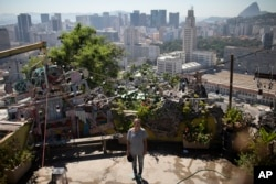 "In this Jan.7, 2020 photo, Ale Roque poses for a photo at the Yellow House cultural center in Rio's first favela Morro da Providencia, Rio de Janeiro, Brazil. I want to make the world green!"" she says and laughs, then collects herself. ""It's because someone has to do it, truthfully that's it. Someone has to do it,"" Roque said. (AP Photo/Silvia Izquierdo)"