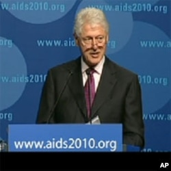 President Clinton speaking at the 18th International AIDS Conference in Vienna