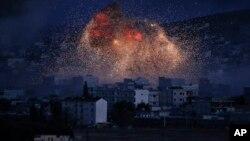 ຄວັນໄຟ ຈາກການໂຈມຕີທາງອາກາດ ຂອງສະຫະລັດ ທີ່ເມືອງ Kobani
