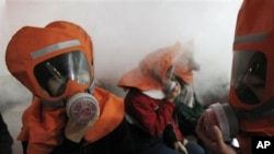 South Korean middle school students learn how to use gas masks in a supposed chemical attack in Seoul, as tensions rise with North Korea, Nov. 30, 2010.