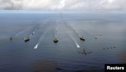 FILE - The USS Nimitz, USS Kitty Hawk and USS John C. Stennis Carrier Strike Groups transit in formation during Valiant Shield 2007 in the Pacific Ocean in this Aug. 14, 2007 photo.