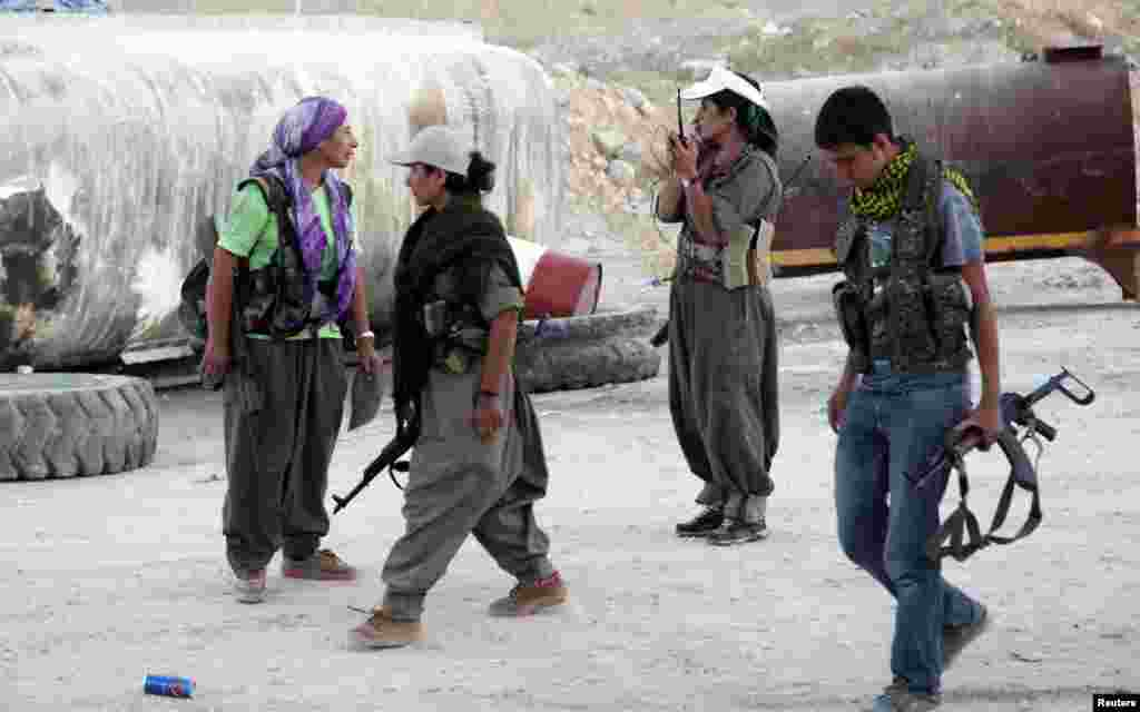 Kurdistan Workers Party (PKK) fighters participate in an intensive security deployment against Islamic State (IS) militants on the front line in Makhmur, Iraq, Aug. 9, 2014.