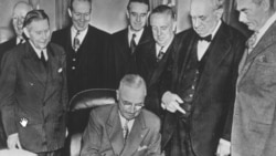 President Harry Truman signing the European Recovery Act