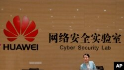 A receptionist stands at the front counter of the Huawei's Cyber Security Lab at the Huawei factory in Dongguan, China's Guangdong province, March 6, 2019. Huawei Technologies Co. is one of the world's biggest supplier of telecommunications equipment.