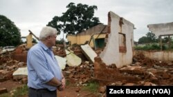 FILE - Stephen O'Brien, the U.N.'s top humanitarian official, looks over the main mosque in Bangassou, Central African Republic, that was burned down and destroyed during attacks in May 2017.