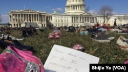 Children's shoes, some from victims of mass shootings, were arranged on the lawn on the U.S. Capitol to protest gun violence in America.