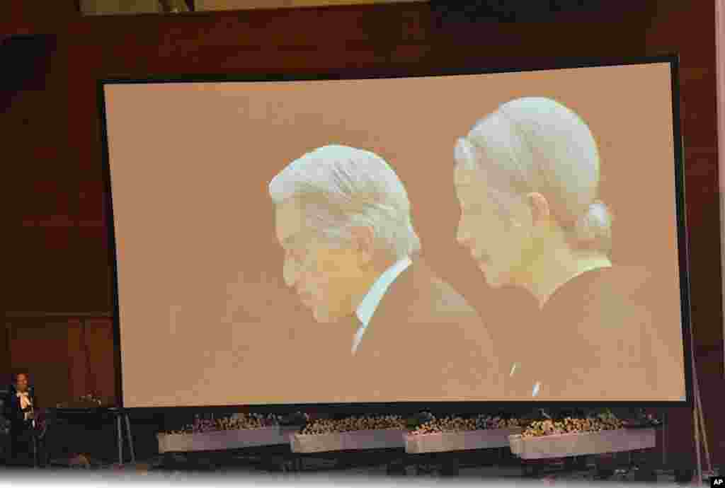 Live television images of the Emperor and Empress being beamed into the memorial ceremony in a gymnasium in Onnagawa, March 9, 2012. (VOA - S. L. Herman)