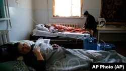 Coronavirus patients lie in an infectious diseases clinic in Stepanakert in the separatist region of Nagorno-Karabakh, Tuesday, Oct. 20, 2020.