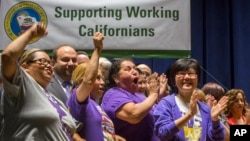 Union workers support California Gov. Jerry Brown signing a bill creating highest statewide minimum wage at $15 an hour by 2022 at the Ronald Reagan building in Los Angeles, April 4, 2016.