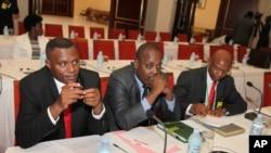From left to right, Burundi opposition members, Ndikumana Delphine, Deputy Secretary General of the United For National Progress, Rwasa Agaton and Leonce Ngendawmana both members of the National Front of Liberation party, sit, during Burundi peace talks
